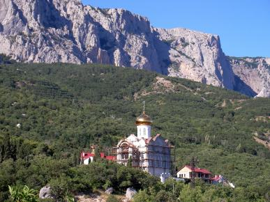 Church of the Kazan Icon of the Mother of God in the mountains in the background Kastropol Baidaro-Kastropol wall in Crimea
