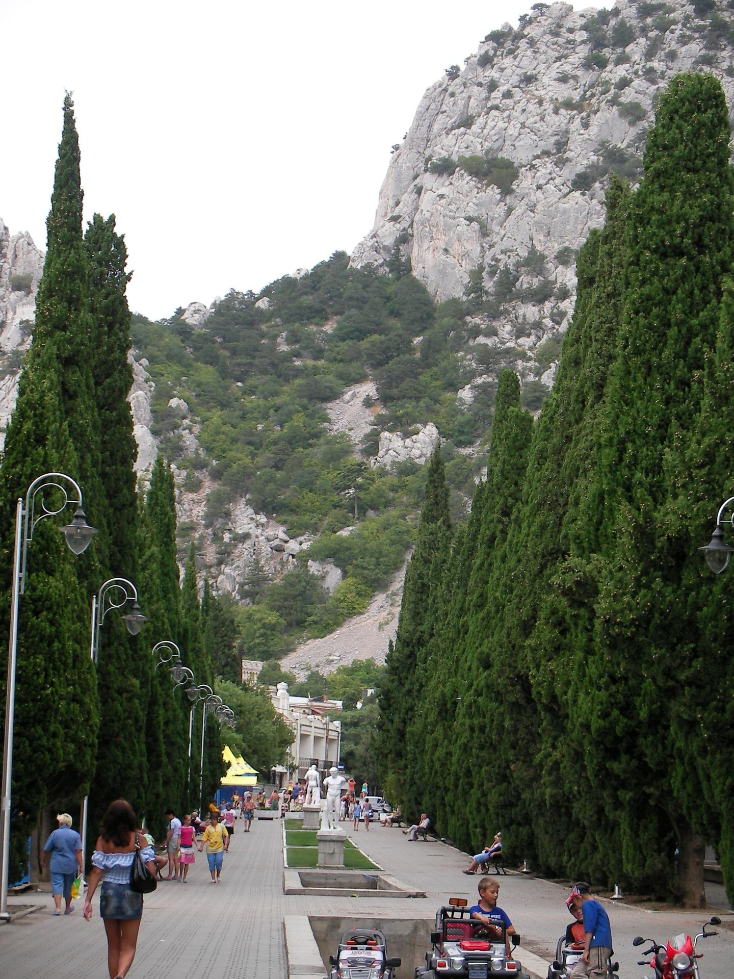 Pyramidal cypress alley with statues in Simeiz in Crimea