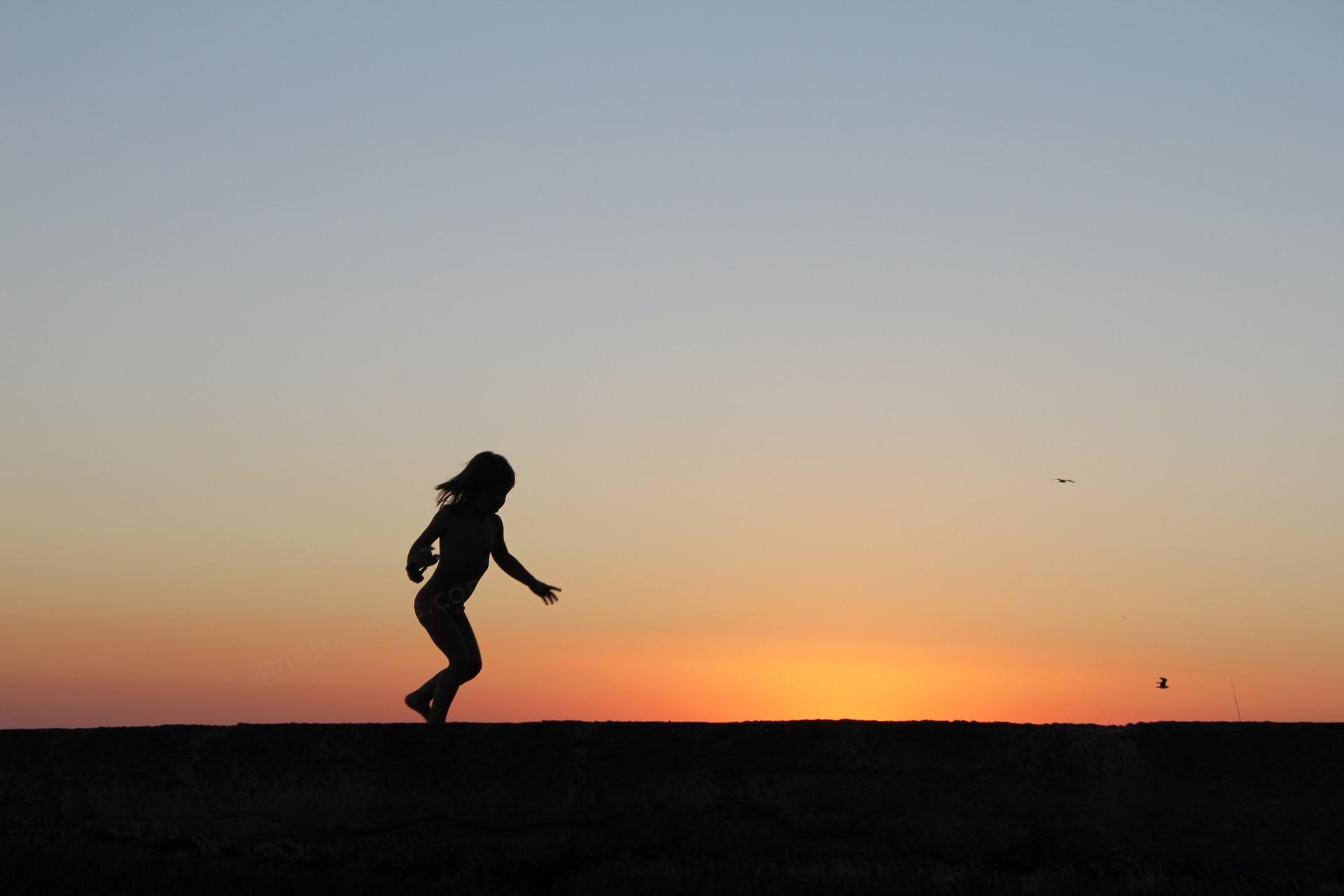 Running girl shown in silhouette