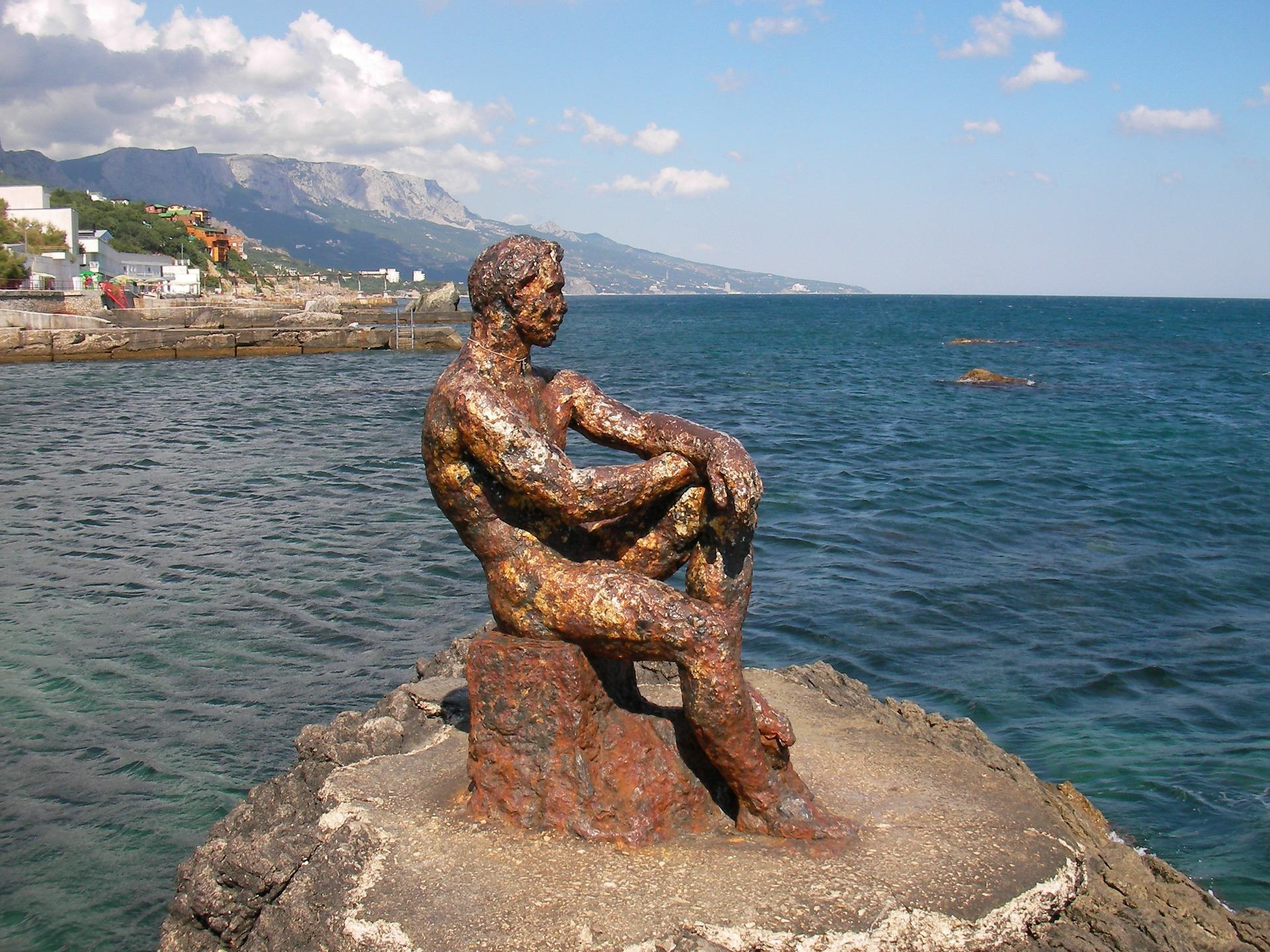 Rusty metal sculpture of man in Foros