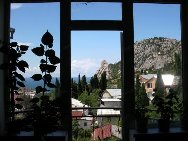 Window view of the sea and mountains